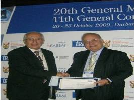 Dr. Mohamed El-Faham presenting the regional prize to Prof. Adnan Badran.
